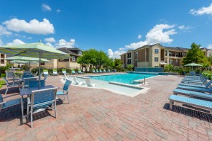 Apartments for Rent in Katy, TX - Pool with Waterfall, Tanning Shelf, Lounges & Tables with Umbrellas